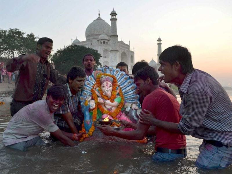 Devotees immerse an idol of Lord Ganesha in Agra. PTI photo