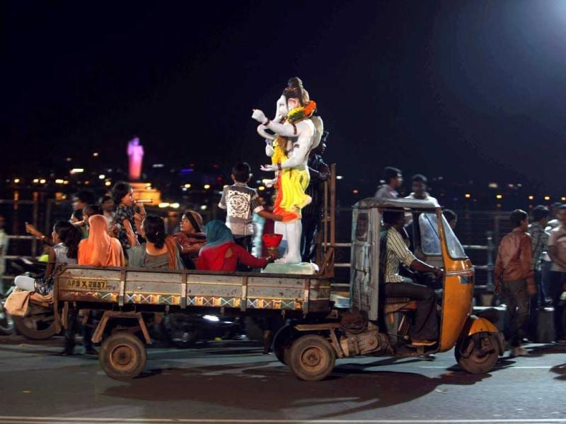 Devotees carry an idol of Lord Ganesha on a mini truck for immersion into the Hussain Sagar Lake in Hyderabad. AP photo