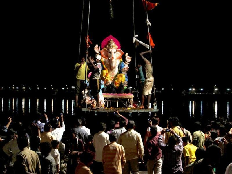 An idol of Lord Ganesha is lifted on a crane for immersion into the Hussain Sagar Lake in Hyderabad. AP photo