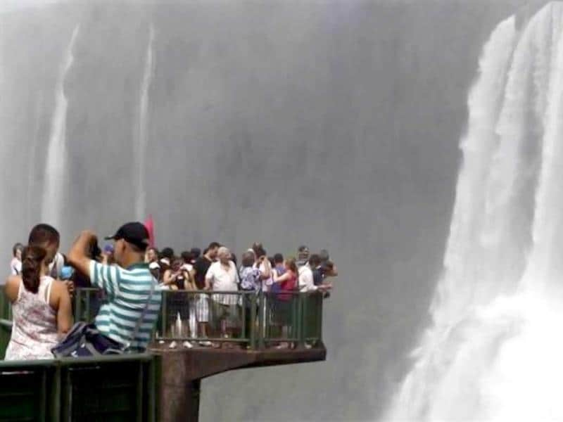 Tourists take pictures from a viewpoint overlooking the Iguazu falls, in Foz do Iguacu, Brazil. Reuters/Jorge Adorno