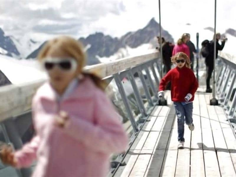 Young girls run on a viewing platform at Tiefenbachkogl mountain (3309 meters) above Mittelbergferner Glacier in the Oetztal Alps in the Austrian province of Tyrol . Reuters/Lisi Niesner
