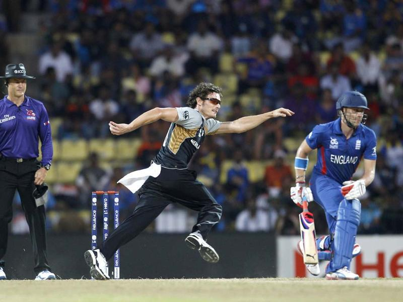 New Zealand's bowler Rob Nicol, center, runs to field the ball after a shot played by England's batsman Eoin Morgan, not seen, during their ICC Twenty20 Cricket World Cup Super Eight match in Pallekele, Sri Lanka. (AP Photo/Aijaz Rahi)