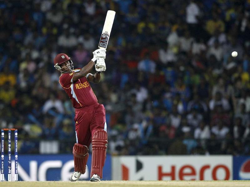 West Indies' batsman Johnson Charles plays a shot during the ICC Twenty20 Cricket World Cup Super Eight match against Sri Lanka in Pallekele, Sri Lanka. (AP Photo/Aijaz Rahi)