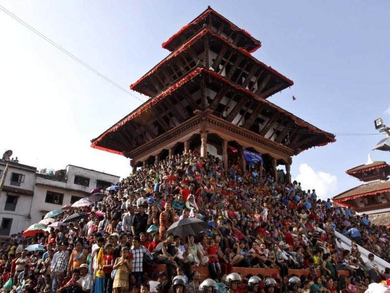Devotees gather to watch a chariot procession of Nepal's living goddess during the Indra Jatra festival in Katmandu, Nepal. AP/Binod Joshi