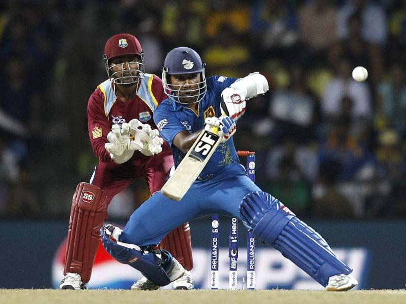 Sri Lanka's captain Mahela Jayawardene, right, plays a shot during the ICC Twenty20 Cricket World Cup Super Eight match against West Indies' in Pallekele, Sri Lanka. (AP Photo/Aijaz Rahi)