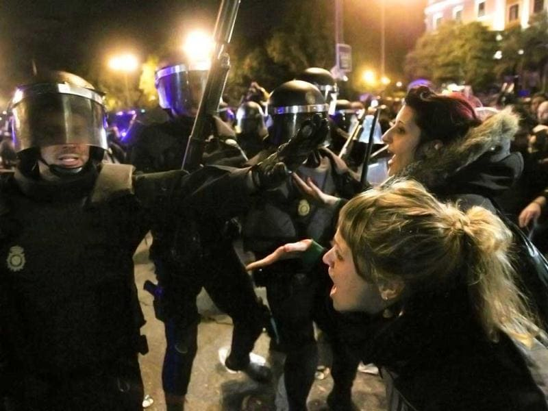 Police clash with protestors during a demonstration in front Parliament against austerity measures announced by the Spanish government in Madrid, Spain. AP Photo
