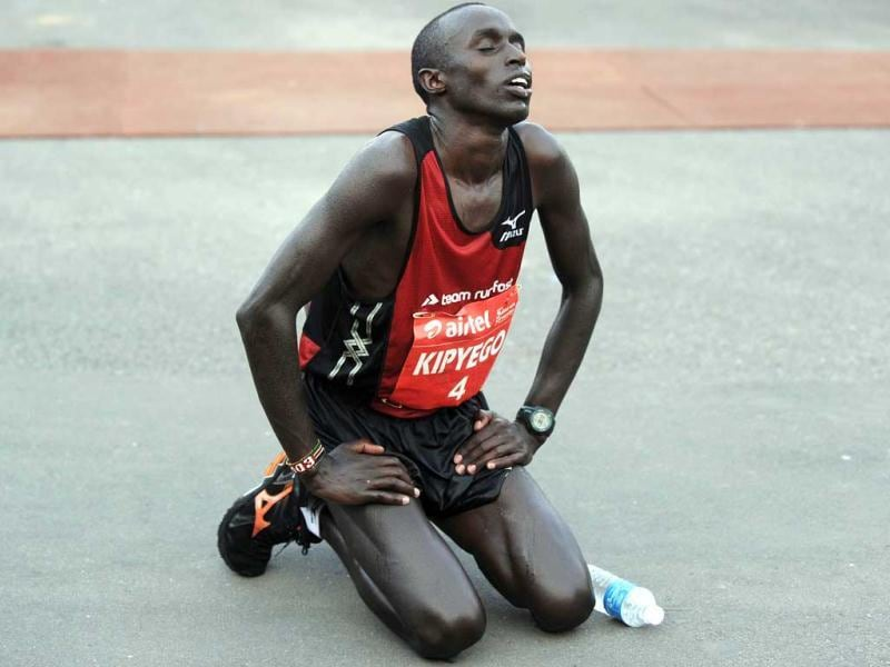 Kenyan Edwin Kipyego reacts after crossing the finishing line for victory in the 2012 Airtel Delhi Half Marathon in New Delhi. AFP Photo