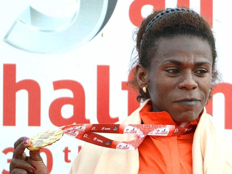 Ethiopian runner Yimer Wude poses with her medal after winning the women's event of the 2012 Airtel Delhi Half Marathon in New Delhi. AFP Photo
