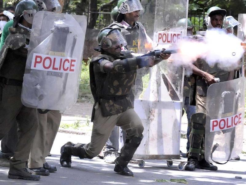 Police fire tear gas at members of the Telangana Students Joint Action Committe (TSJAC) as they prevent the students from marching during a protest rally held to demand the separate state of Telangana at the Osmania University in Hyderabad. AFP PHOTO / Noah SEELAM