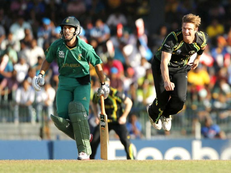 Australia's bowler Shane Watson, right, delivers the ball as South Africa's batsman Farhaan Behardien watches that during their ICC Twenty20 Cricket World Cup Super Eight match in Colombo, Sri Lanka. (AP Photo/Eranga Jayawardena)