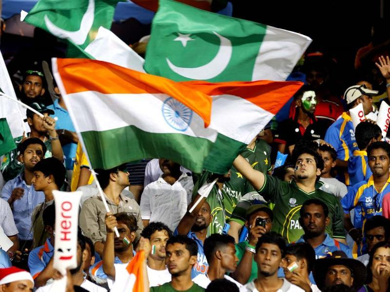 Indian and Pakistan cricket fans wave their national flags during an ICC Twenty20 Cricket World Cup Super Eight match between the two countries in Colombo. (AP Photo/Eranga Jayawardena)
