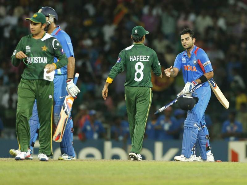 Virat Kohli, right, shakes hands with Mohammad Hafeez after beating them by 8 wickets in the ICC Twenty20 Cricket World Cup Super Eight match between India and Pakistan in Colombo. (AP Photo/Eranga Jayawardena)
