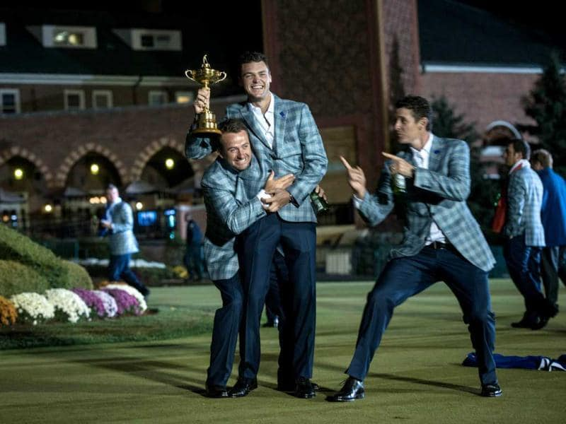 Team Europe's Graeme McDowell (L) of Northern Ireland, Martin Kaymer (C) of Germany and Justin Rose of England pose with the Ryder Cup after the final day of the 39th Ryder Cup at the Medinah Country Club in Medinah, Illinois. AFP Photo