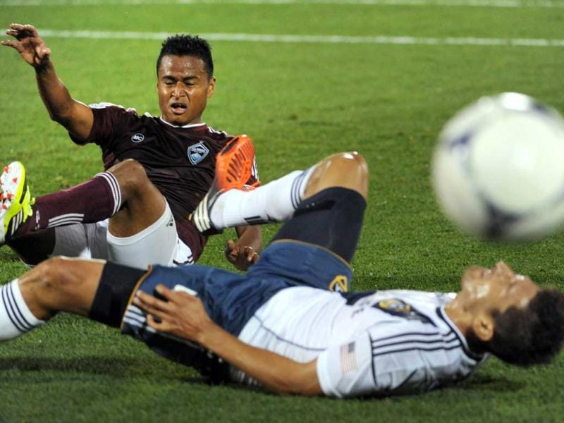 Colorado Rapids midfielder Jaime Castrillon gets tangled up with Los Angeles Galaxy midfielder Omar Gonzalez (R) during their MLS soccer match in Commerce City, Colorado. The game ended in a 1-1 tie. AP Photo