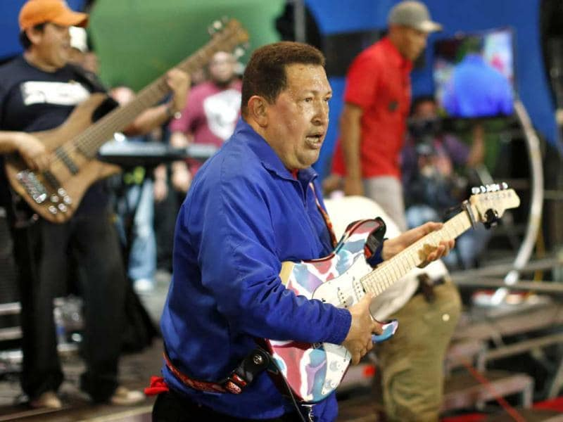 Venezuela's President Hugo Chavez plays a guitar during a campaign rally in Cabimas in the state of Zulia. Reuters Photo