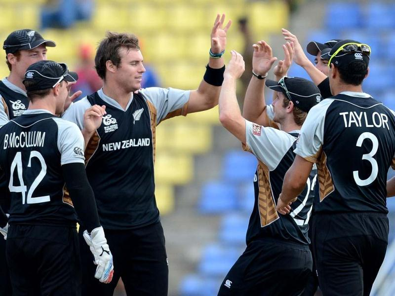 New Zealand cricketer Doug Bracewell (C) celebrates the wicket of West Indies cricketer Johnson Charles with teammates during the ICC Twenty20 Cricket World Cup's Super Eight match between New Zealand and West Indies at the Pallekele International Cricket Stadium in Pallekele. AFP Photo/Prakash Singh