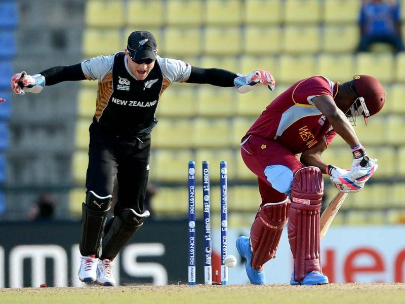 New Zealand cricketer Brendon McCullum (L) celebrates the clean bowl of West Indies cricketer Darren Bravo (R) by Nathan McCullum during the ICC Twenty20 Cricket World Cup's Super Eight match between New Zealand and West Indies at the Pallekele International Cricket Stadium in Pallekele. AFP Photo/Prakash Singh