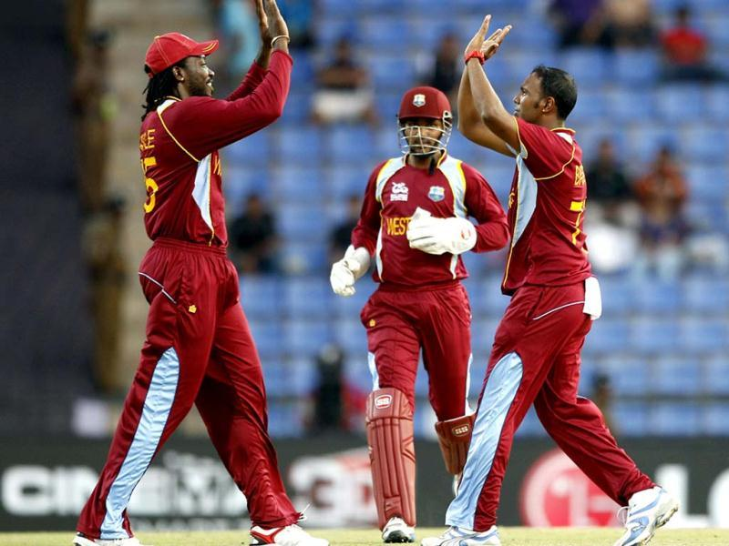 West Indies' bowler Samuel Badree, right, celebrates with teammate Chris Gayle, left, the dismissal of New Zealand's batsman Brendon McCullum, not seen, during the ICC Twenty20 Cricket World Cup Super Eight match in Pallekele, Sri Lanka. (AP Photo/Aijaz Rahi)