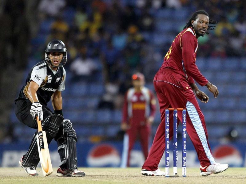 West Indies' bowler Chris Gayle, right, watches the ball as New Zealand's captain Ross Taylor runs to make it to the crease during their ICC Twenty20 Cricket World Cup Super Eight match in Pallekele, Sri Lanka. (AP Photo/Aijaz Rahi)