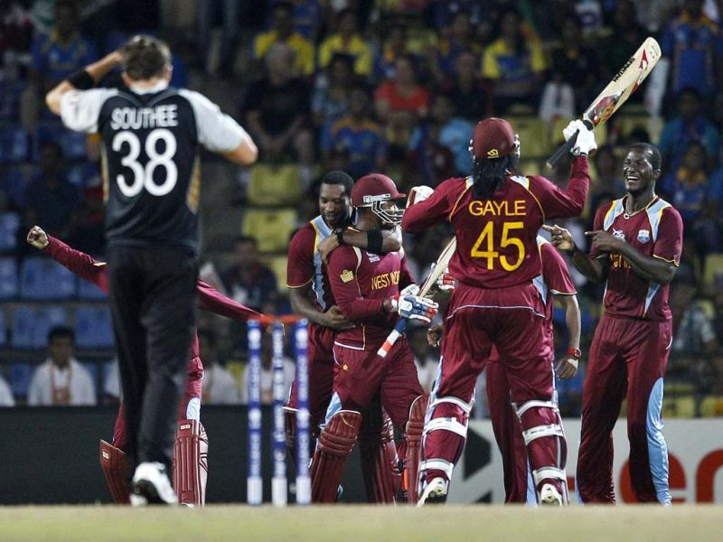 West Indies' captain Darren Sammy, right, celebrates with teammates their Super Over win over New Zealand in their ICC Twenty20 Cricket World Cup Super Eight match in Pallekele. (AP Photo/Aijaz Rahi)