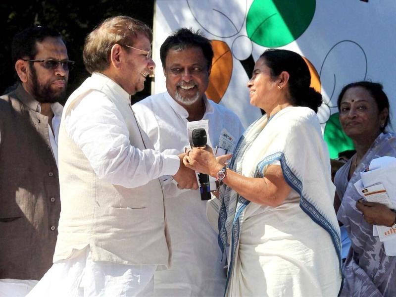 Trinamool Congress chief and West Bengal chief minister Mamata Banerjee greets NDA convener Sharad Yadav at a party rally against FDI in multi-brand retail and diesel price hike in New Delhi. (PTI Photo by Atul Yadav)