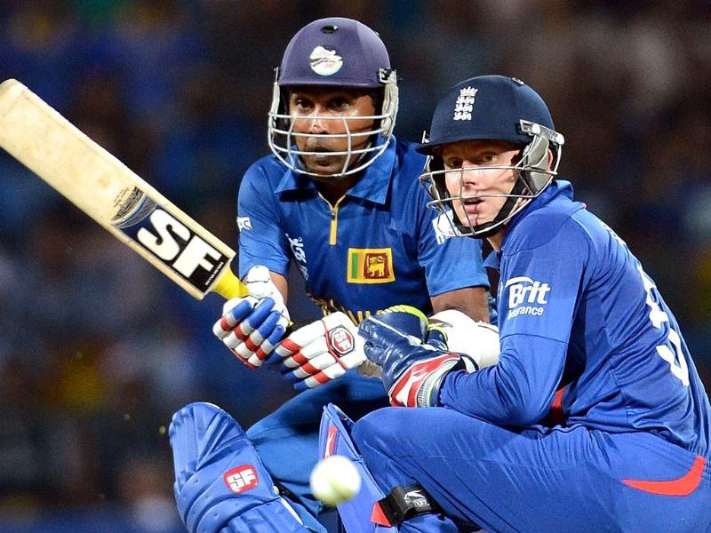 England wicket keeper Jonny Bairstow (R) watches as Sri Lanka cricketer Mahela Jayawardene plays a shot during the ICC Twenty20 Cricket World Cup Super Eight match between England and Sri Lanka at the Pallekele International Cricket Stadium in Pallekele. AFP Photo/ Prakash Singh