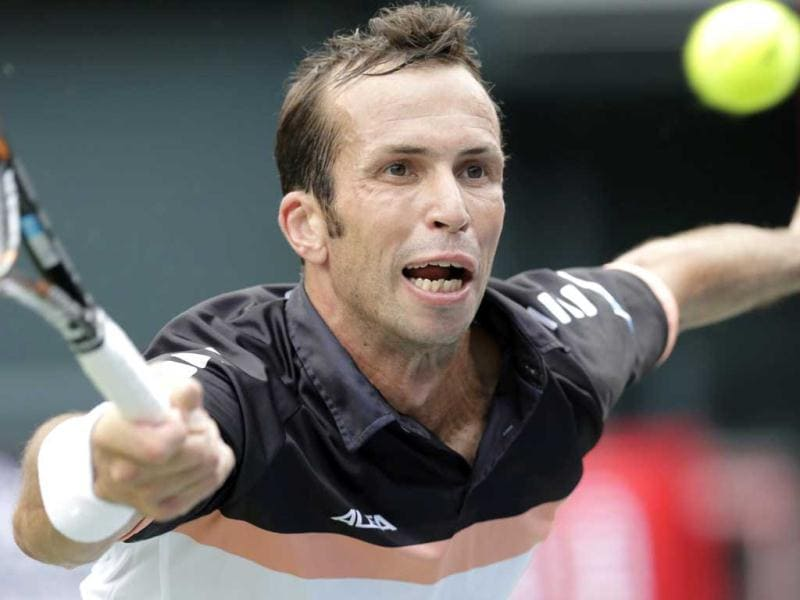 Radek Stepanek of Czech Republic returns the ball against Milos Raonic of Canada during their first round match of the Japan Open tennis championships in Tokyo. AP Photo