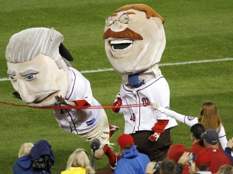 The George Washington mascot dives across the line to edge out Teddy Roosevelt (R) to win the nightly Presidents Race during the fourth inning of the MLB National League baseball game between the Philadelphia Phillies and Washington Nationals in Washington. Reuters Photo