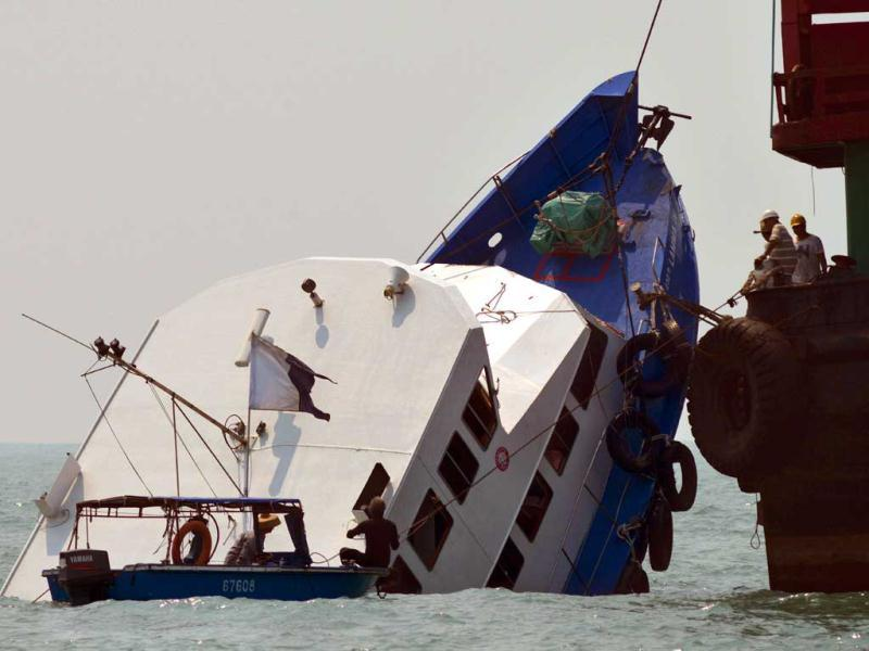 The bow of the Lamma IV boat is seen partially submerged during rescue operations the morning after it collided with a Hong Kong ferry killing over 30 people. AFP Photo