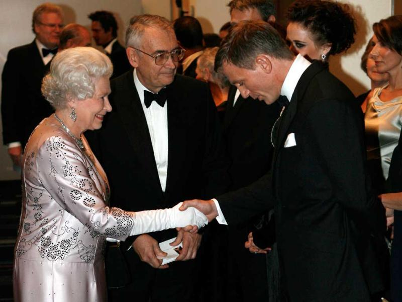 Britain's Queen Elizabeth II, left, meets actor Daniel Craig, the new James Bond, during the world premiere of the latest James Bond movie Casino Royale at the Odeon cinema in Leicester Square in London. (AP Photo/Stephen Hird, Pool, File)