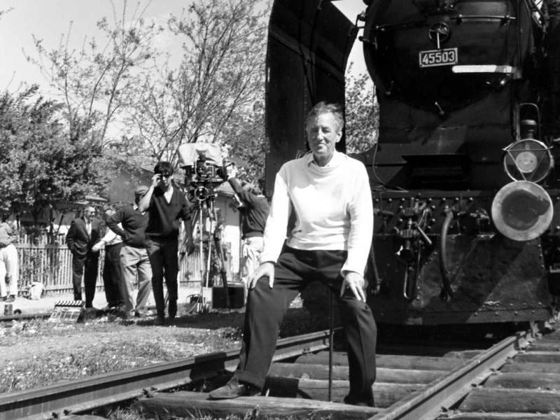 British writer Ian Fleming, author of the James Bond spy thrillers, sits in front of a Turkish train, as a gag, during a visit to the set of the film From Russia With Love in Istanbul, Turkey. Fleming, a former World War II intelligence officer, created 007 as a sort of fantasy alter-ego. (AP Photo/File)