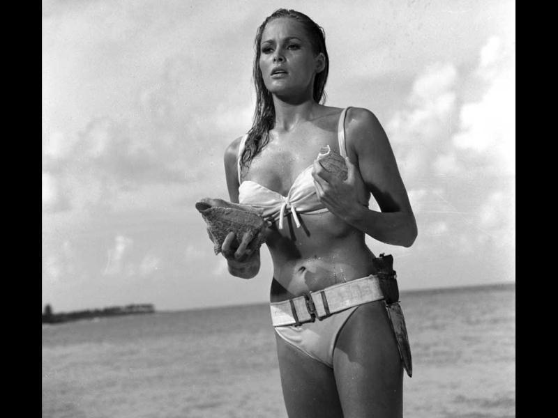 This undated publicity photo provided by United Artists and Danjaq, LLC shows Ursula Andress in a scene from the James Bond film, Dr. No. Her image personifies the gorgeous, mysterious cool of the Bond girl. The film is included in the MGM and 20th Century Fox Home Entertainment Blu-Ray Bond 50 anniversary set. (AP Photo/United Artists and Danjaq, LLC)
