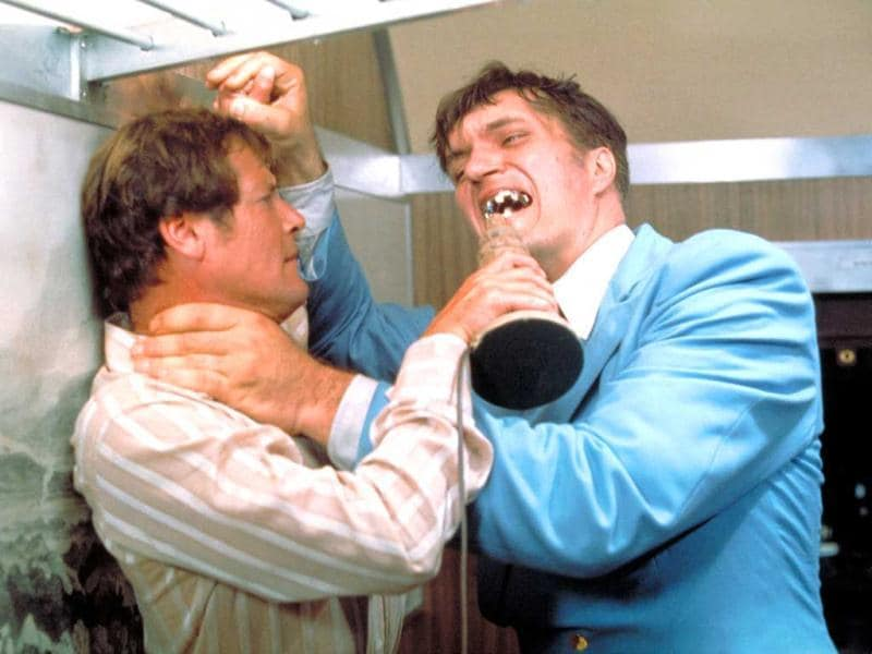 This undated publicity photo provided by United Artists and Danjaq, LLC shows Richard Kiel, right, as Jaws and Roger Moore, as James Bond, fighting in the 1977 film, The Spy Who Loved Me. Those teeth could do some serious damage. The film is included in the MGM and 20th Century Fox Home Entertainment Blu-Ray
