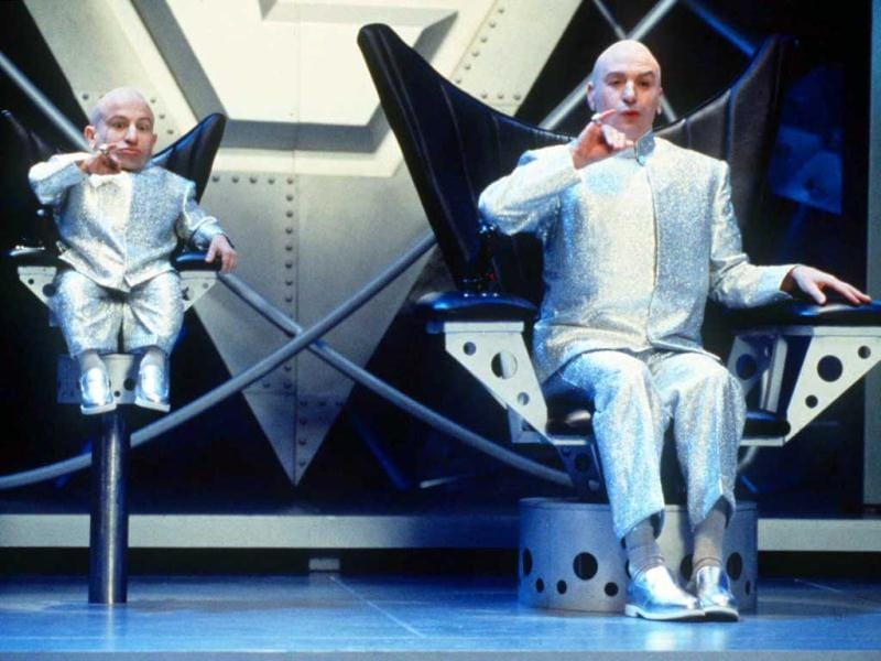In this undated publicity file photo provided by New Line Cinema, Mike Myers, right, and Verne J. Troyer perform in a scene from New Line Cinema's comedy Austin Powers: The Spy Who Shagged Me. The movie, a James Bond spoof, stars Mike Myers as the sexually charged man of mystery. The Austin Powers movies have done the best Bond parodies. (AP Photo/New Line Cinema, K. Wright, HO, File)