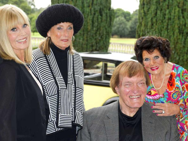 Actors, from left, Britt Ekland, Tania Mallet, Richard Kiel and Eunice Gayson pose at a photocall for Bond 50 on Friday, Sept. 21, 2012 in London. (Photo by Jonathan Short/Invision/AP)
