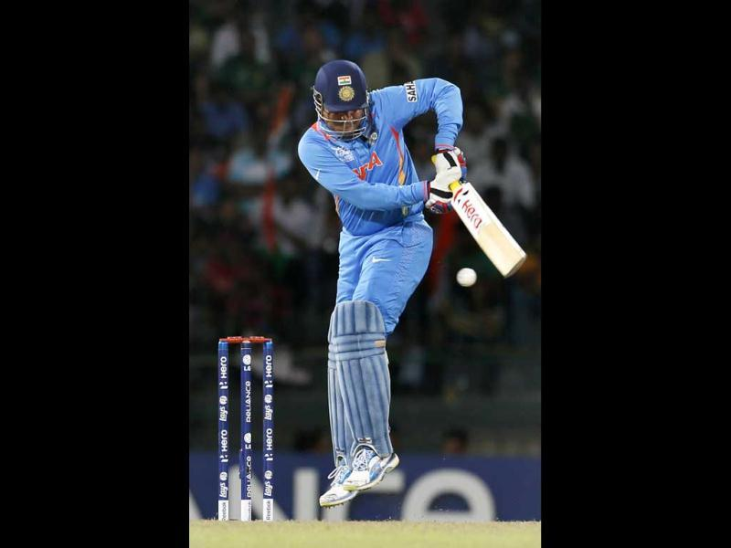 Virender Sehwag bats during the ICC Twenty20 Cricket World Cup Super Eight match between India and South Africa in Colombo, Sri Lanka. AP Photo/Gemunu Amarasingh