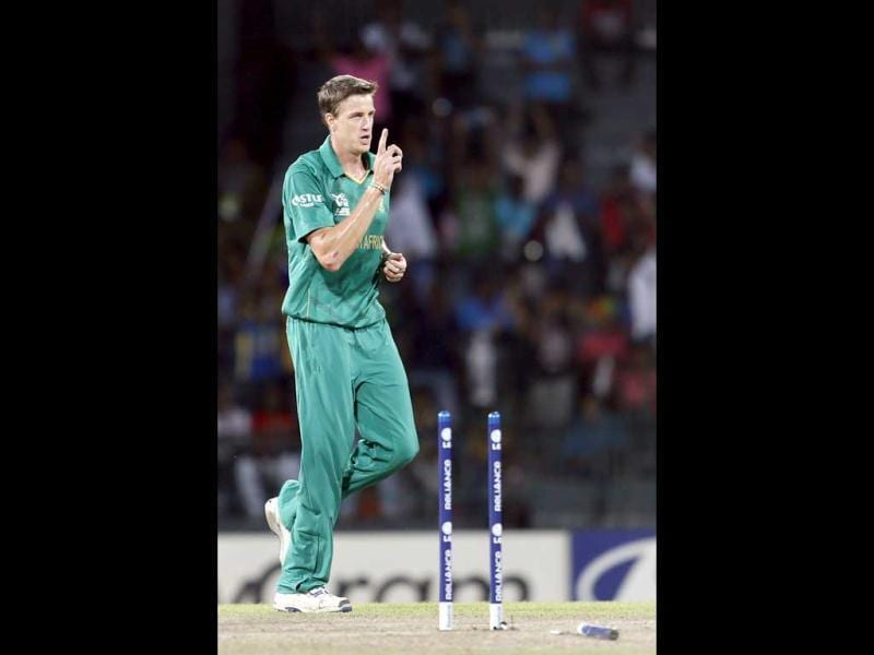 South Africa's bowler Morne Morkel celebrates the dismissal of Gautam Gambhir, unseen during the ICC Twenty20 Cricket World Cup Super Eight match between India and South Africa in Colombo, Sri Lanka. AP Photo/Gemunu Amarasinghe