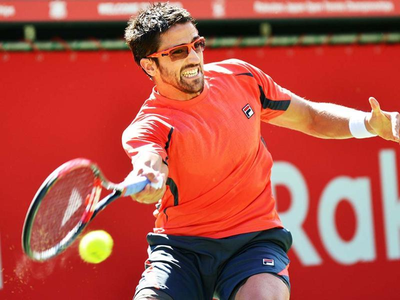 Janko Tipsarevic of Serbia hits a return shot against Marco Chiudinelli of Switzerland during their men's singles second round match at the Japan Open tennis tournament in Tokyo. AFP/Kazuhiro Nogi