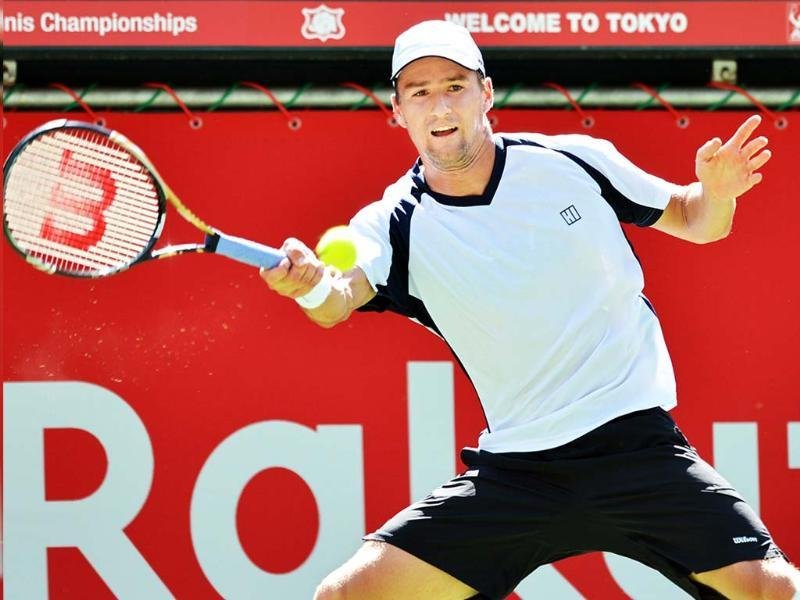 Marco Chiudinelli of Switzerland returns a shot against Janko Tipsarevic of Serbia during their men's singles second round match at the Japan Open tennis tournament in Tokyo. AFP/Kazuhiro Nogi