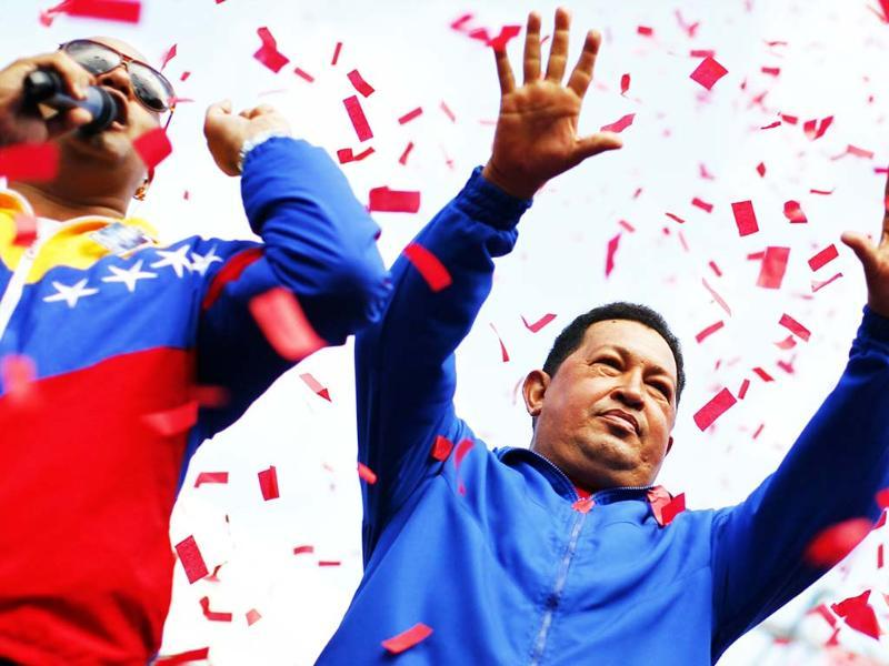 Venezuela's President and presidential candidate Hugo Chavez waves to supporters during a campaign rally in Maracay, in the state of Yaracuy. Reuters/UNI