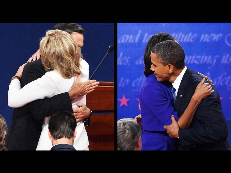 This combination of images show US President Barack Obama and Republican presidential candidate Mitt Romney embracing their spouses after the first presidential debate at the university of Denver in Denver, Colorado. (AFP Photo)