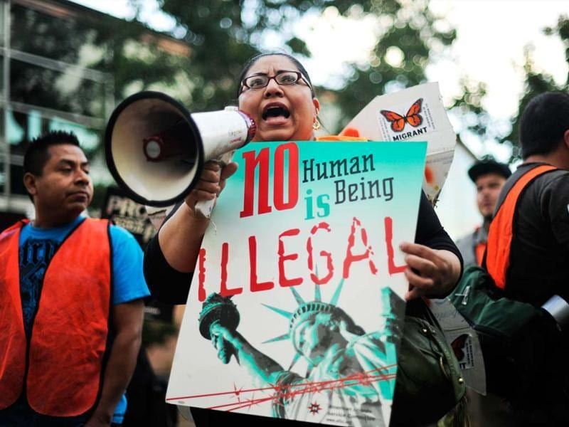 Esmeralda Dominguez demonstrates against the deportation of illegal immigrants, during a protest at the University of Denver, site of the presidential debate in Denver. (AP Photo)