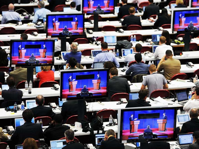 Journalists watch the first 2012 US Presidential Debate at the University of Denver in Denver. (AP Photo)