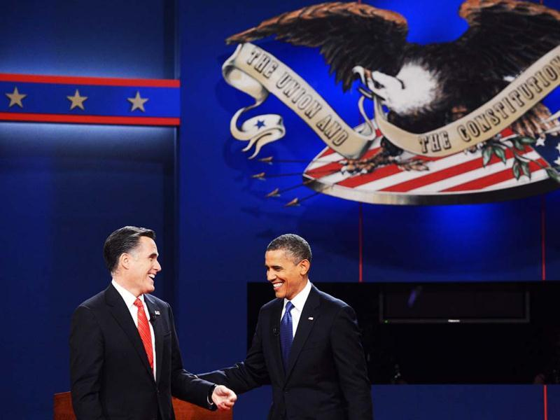 President Barack Obama (L) and Republican presidential nominee Mitt Romney share a laugh at the end of the first presidential debate in Denver. (Reuters)