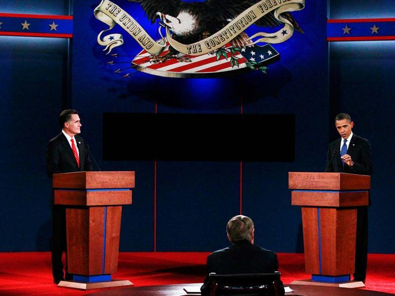 US President Barack Obama answers a question as Republican presidential nominee Mitt Romney listens during the first presidential debate in Denver. (Reuters)