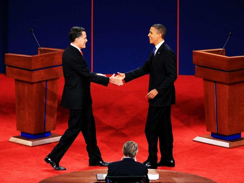 Democratic presidential candidate, US President Barack Obamashakes hands with Republican presidential candidate, former Massachusetts Gov. Mitt Romney during the Presidential Debate at the University of Denver in Denver, Colorado. (AFP Photo)