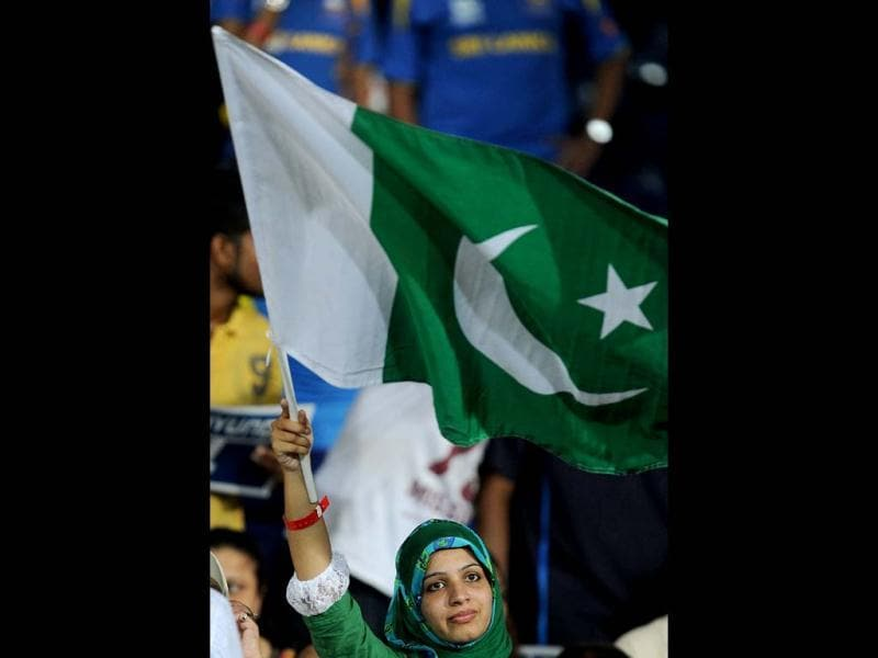 A Pakistan fan waves a national flag during the ICC Twenty20 Cricket World Cup's semi-final match between Sri Lanka and Pakistan at the R Premadasa International Cricket Stadium in Colombo. AFP Photo/ Lakruwan Wanniarachchi