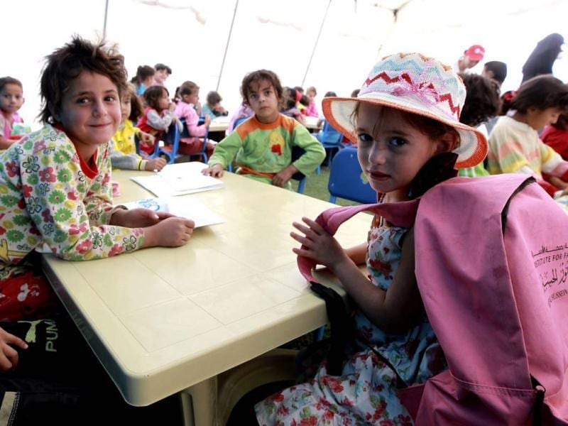 Syrian child refugees attend their fourth day of school at Al Zaatri refugee camp, in the Jordanian city of Mafraq, near the border with Syria. Reuters/Muhammad Hamed