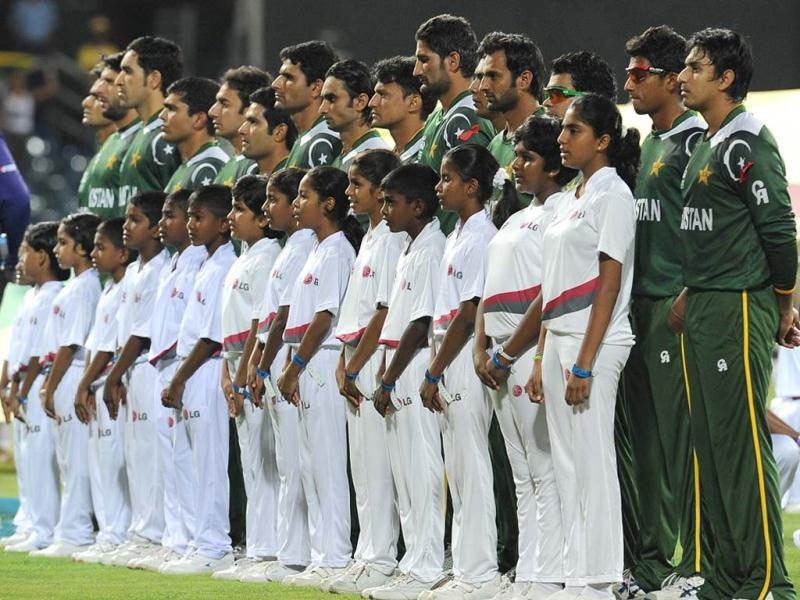 Pakistan cricketers observe their national anthem before the start during the ICC Twenty20 Cricket World Cup's semi-final match between Sri Lanka and Pakistan at the R Premadasa International Cricket Stadium in Colombo. AFP Photo/ Lakruwan Wanniarachchi