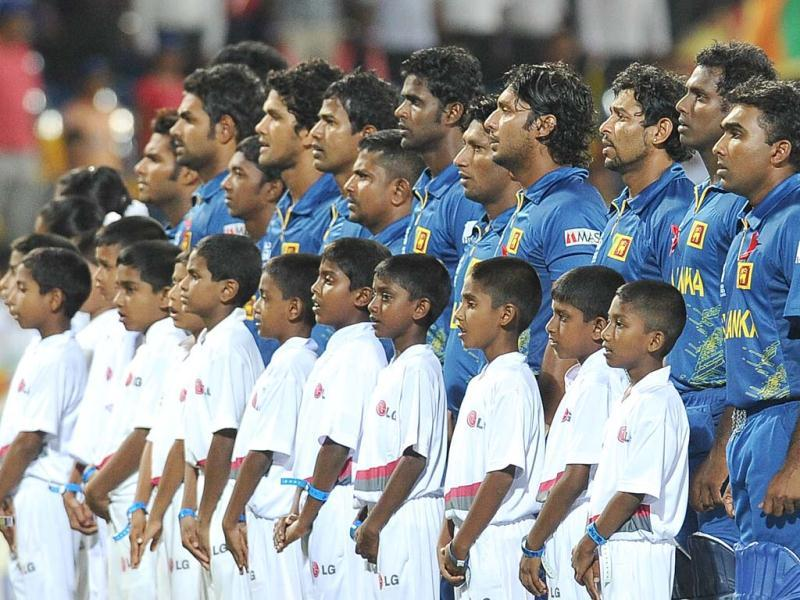 Sri Lankan cricketers observe their national anthem before the start during the ICC Twenty20 Cricket World Cup semi-final match between Sri Lanka and Pakistan at the R Premadasa International Cricket Stadium in Colombo. AFP Photo/Lakruwan Wanniarachchi